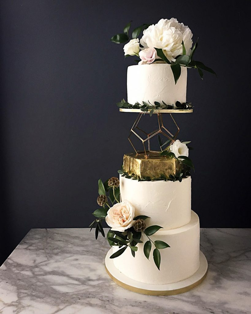 wedding cake with geometric stand