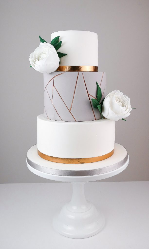 Grey and White Tiered Cake With Bronze Geometric Details