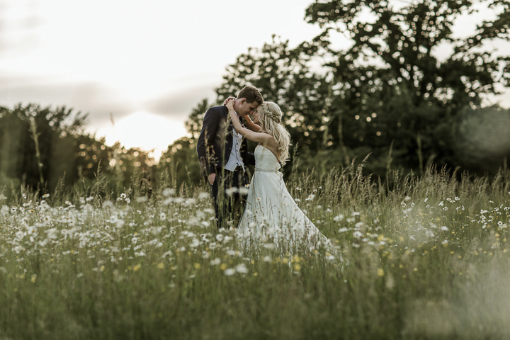 Bride and Groom in Daisy Field