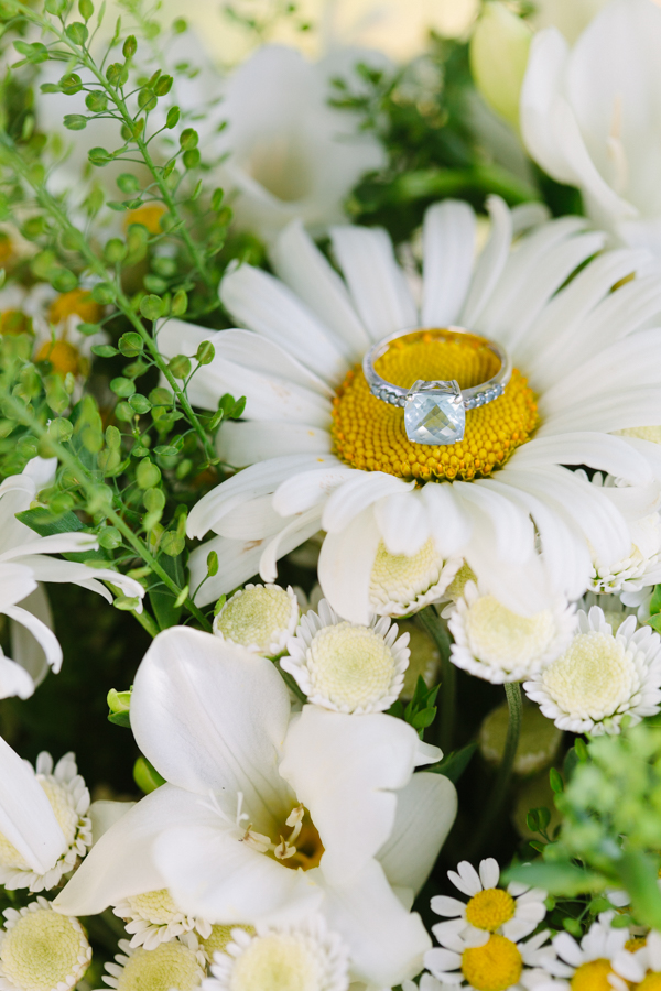 Wedding Ring Laying On Top Of A Daisy
