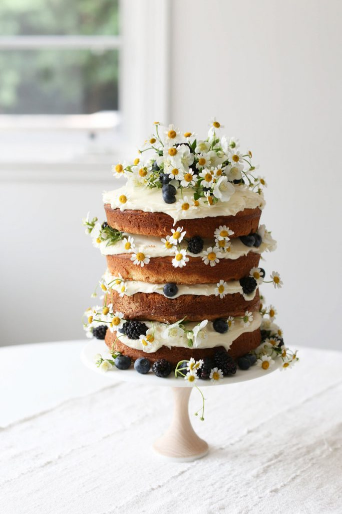 Naked Cake Decorated With Daisies & Fresh Fruit