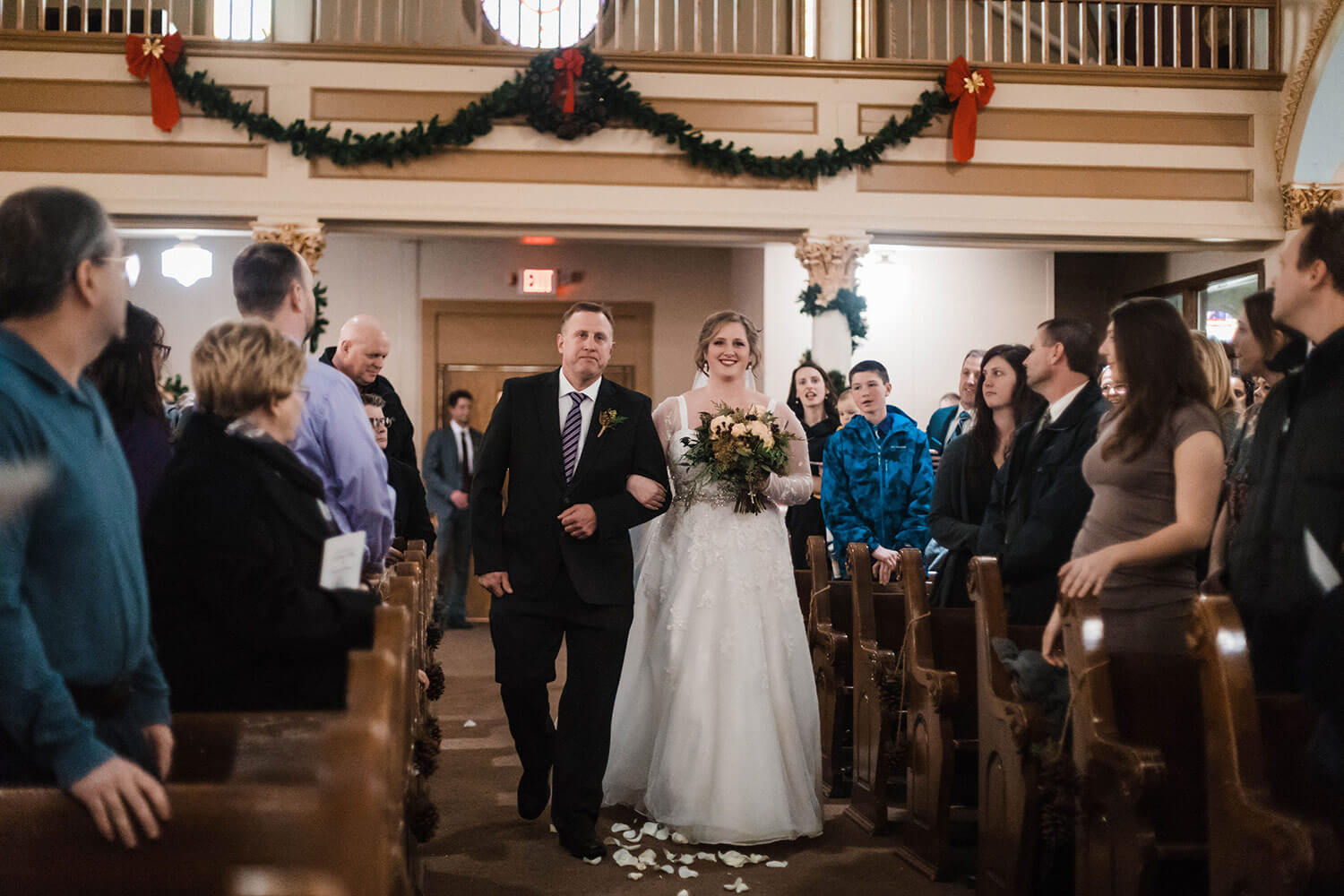 Father walking bride down aisle at church