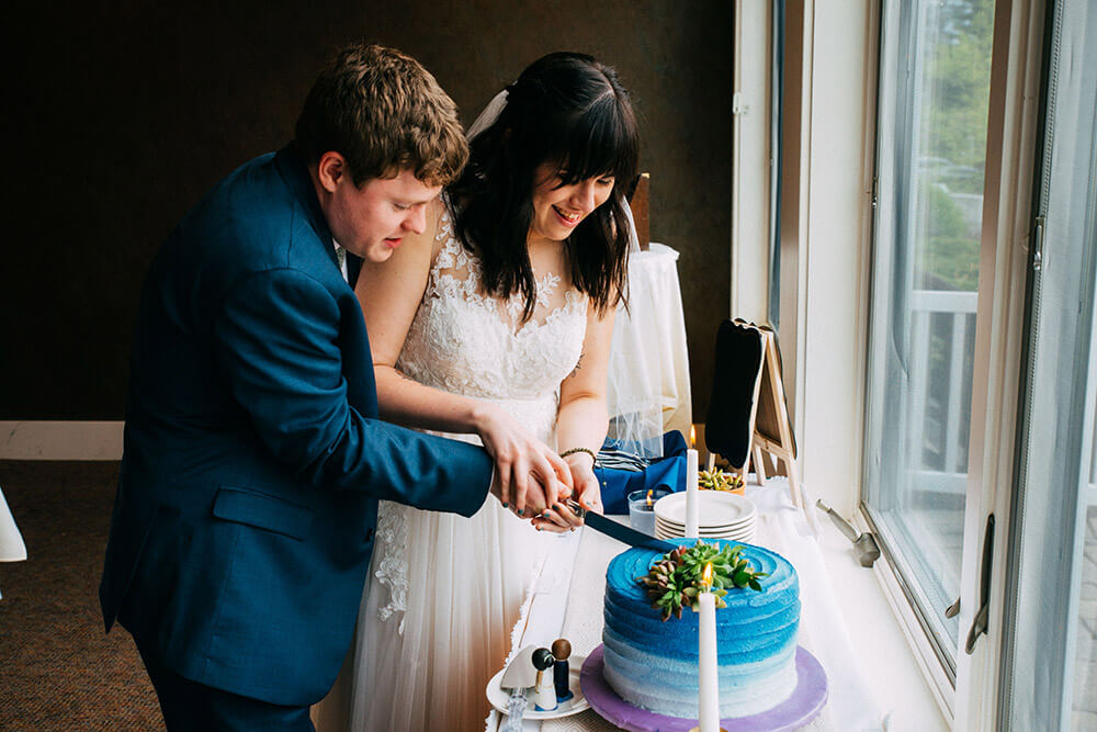 Bride & Groom Cutting Wedding Cake