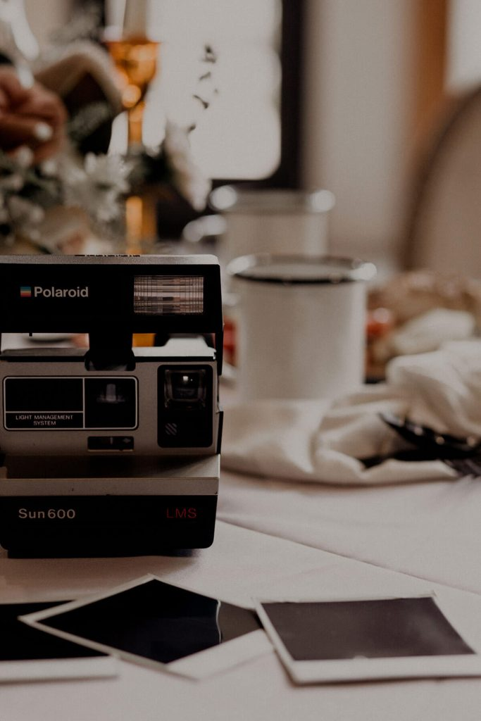 Incorporate A Polaroid Camera Into Your Wedding Decor for A Vintage Touch