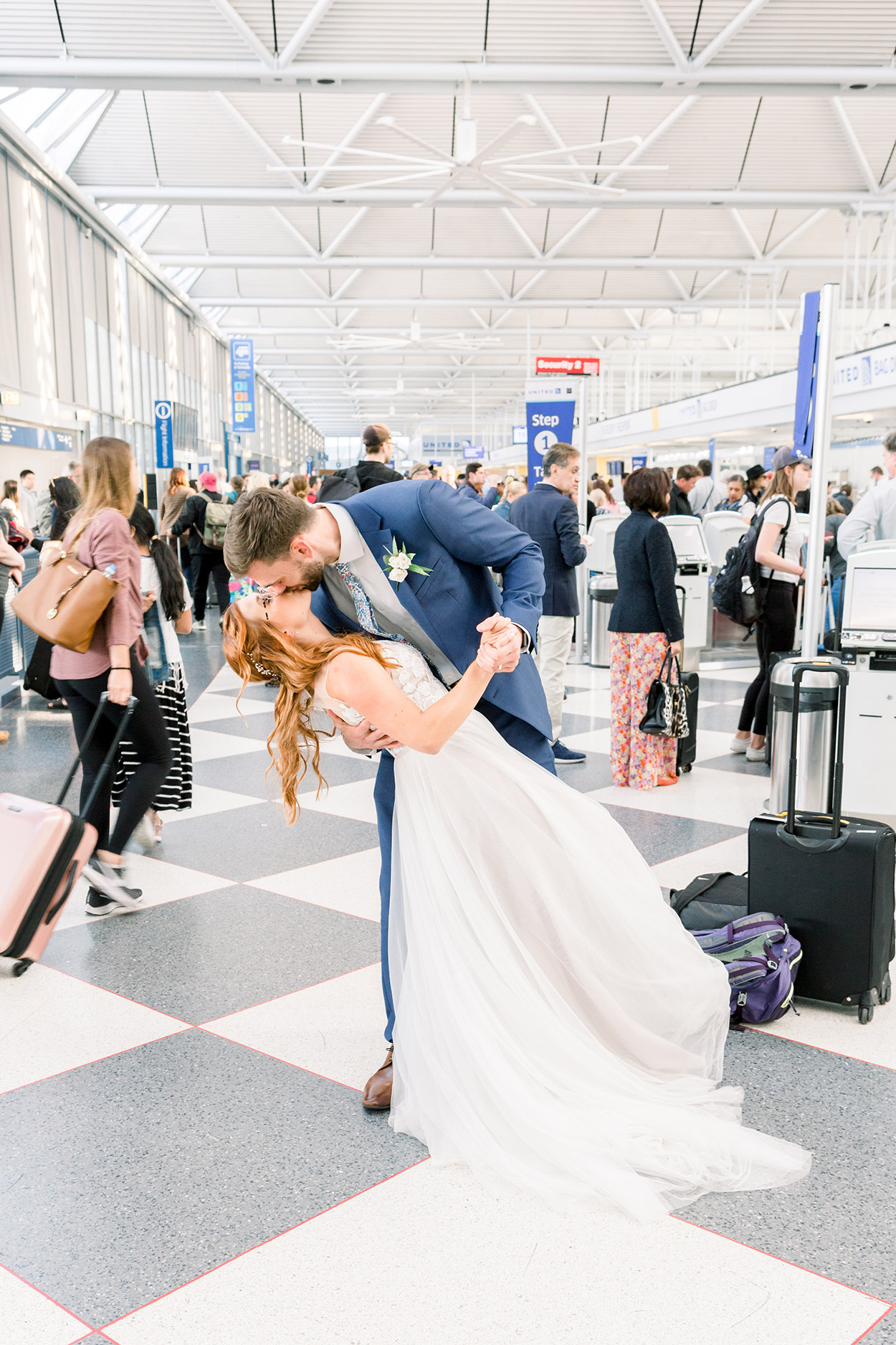 Bride and Groom Kissing at Airport