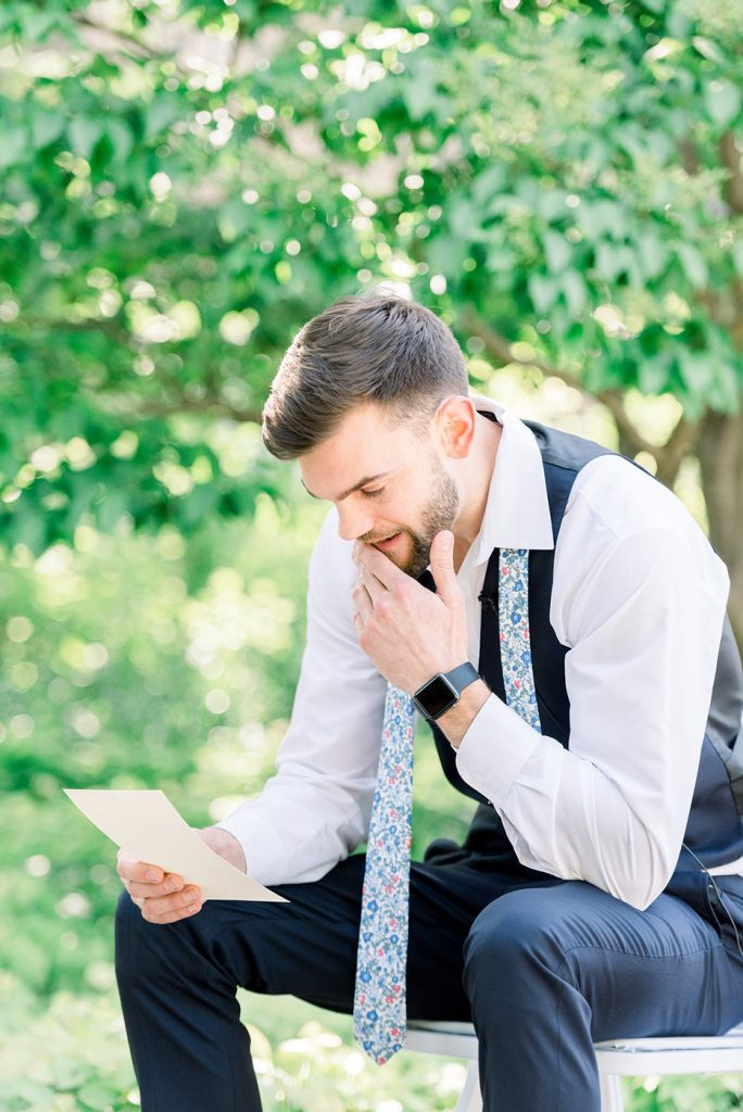 Groom Reading Note From Bride on Wedding Day