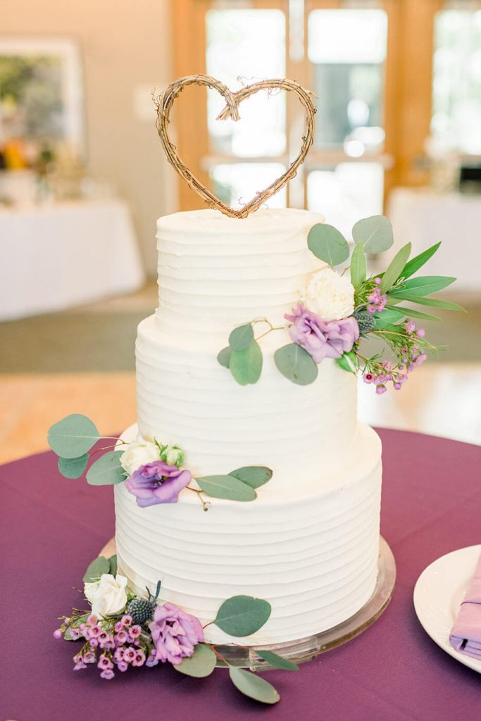 White Tiered Wedding Cake with Lavender Flowers