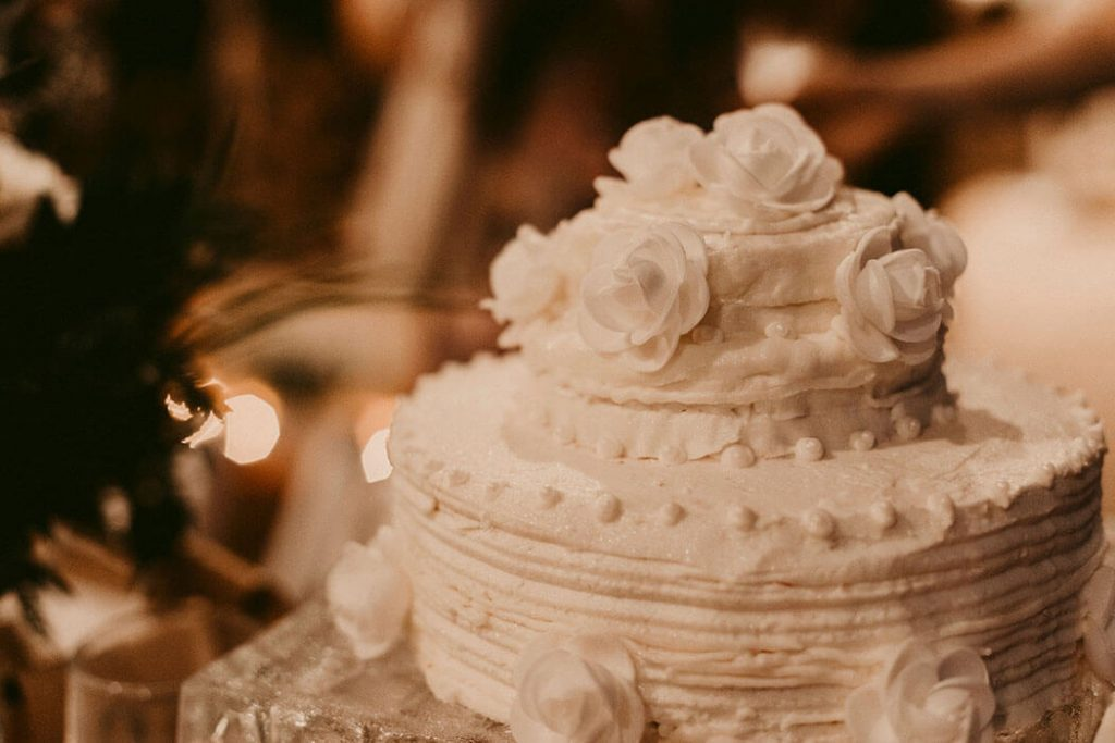 delicate and simple white wedding cake