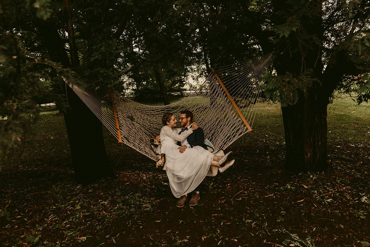 couple relaxing in hammock after wedding ceremony