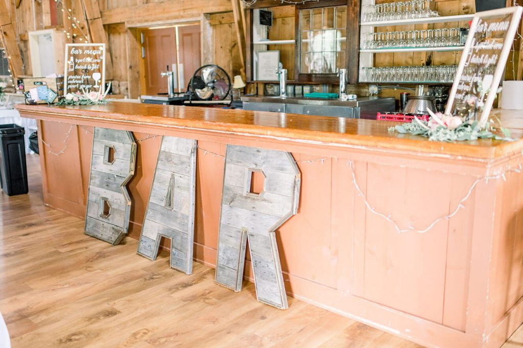 bar decor for barn wedding reception