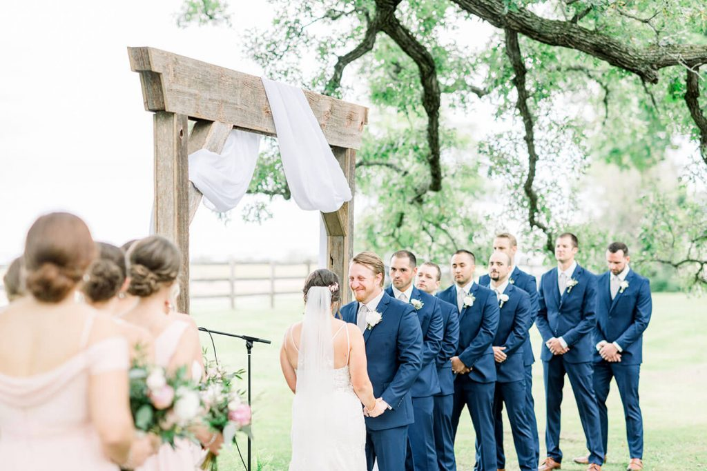 couple saying vows at sugarland barn