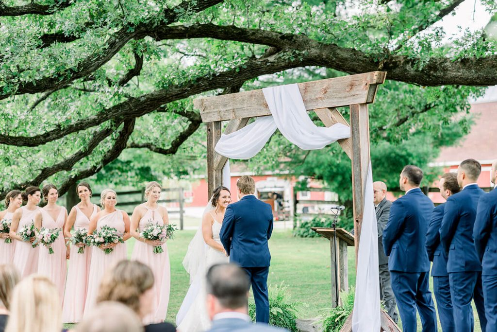 outdoor ceremony at sugarland barn