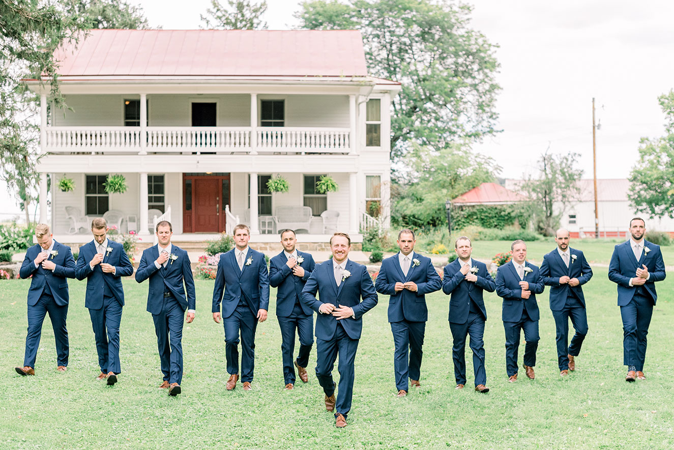 groom and groomsmen in navy blue