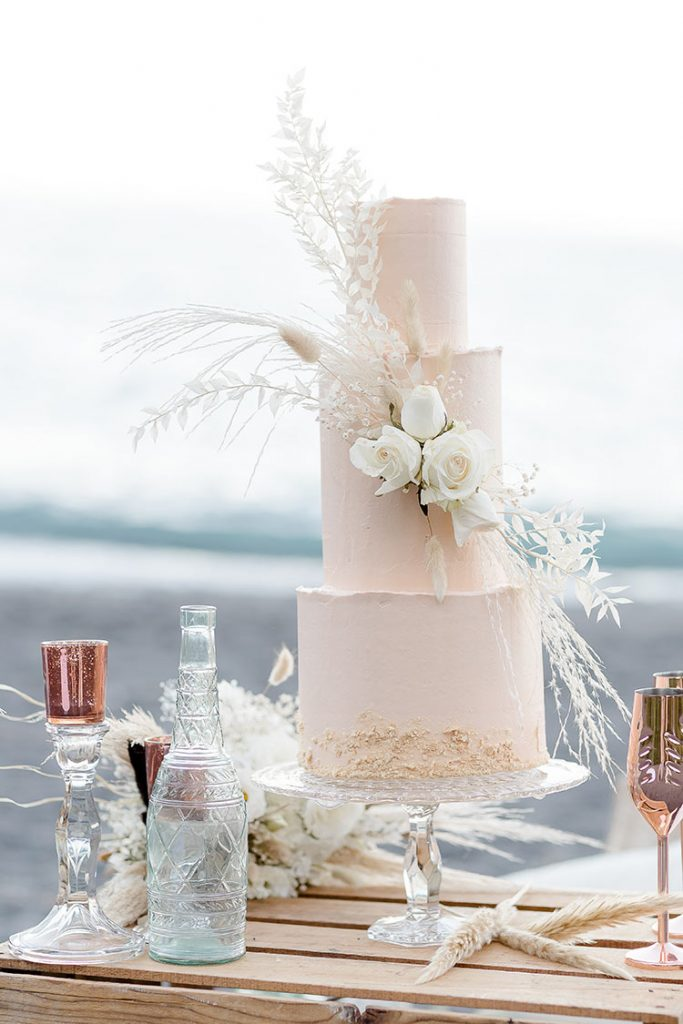 Light Pink Wedding Cake With Ivory Flowers