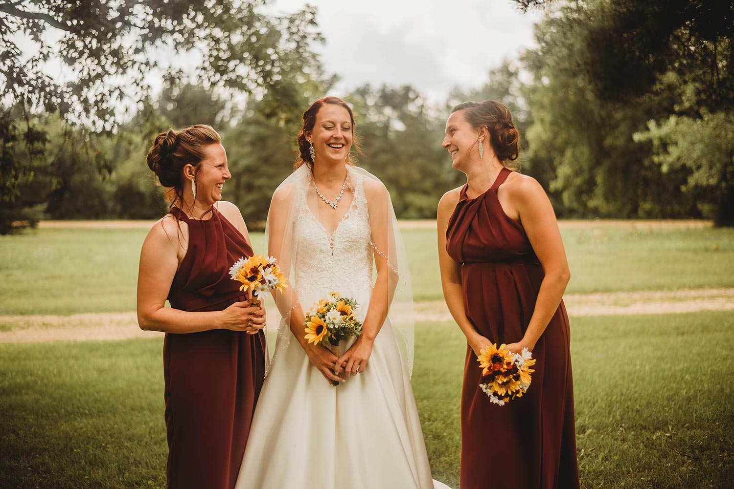 Bridesmaids in Deep Red With Sunflower Bouquets